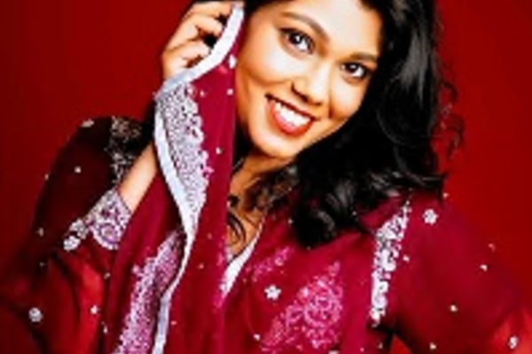 shazeaa ishmael dressed in red and smiling