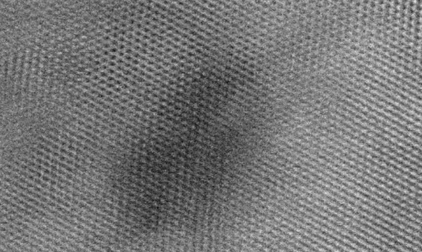 High resolution TEM image of radiation damage in complex oxide