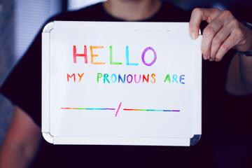 A noticeboard stating personal pronouns